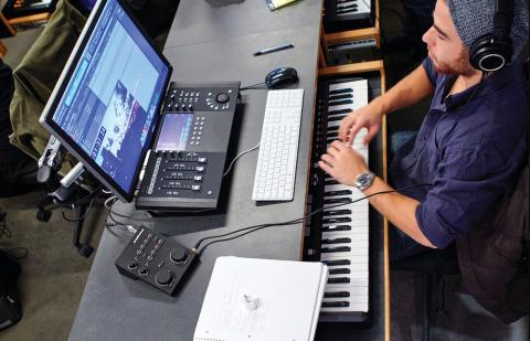Student at a computer and a keyboard