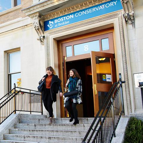 Conservatory students leaving an academic building