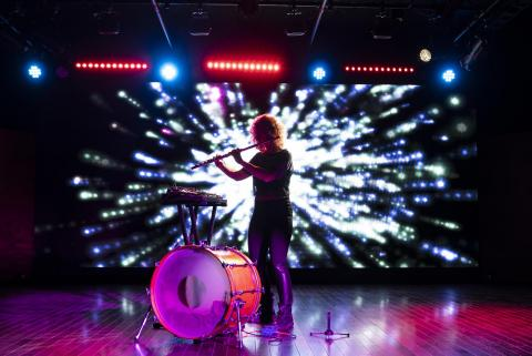 Photo of a student performing in Berklee NYC's Black Box Theater
