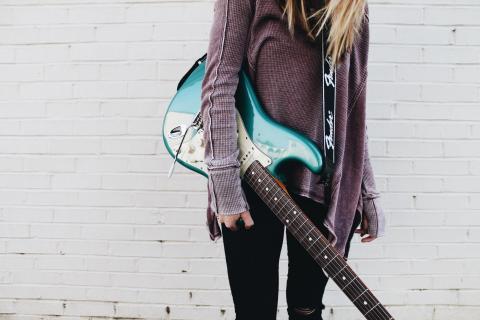 Girl holding a guitar