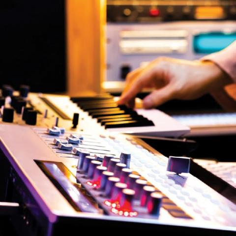 Musician's hands on an EDI